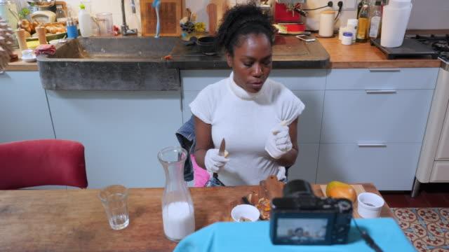 Female vlogger peeling turmeric
