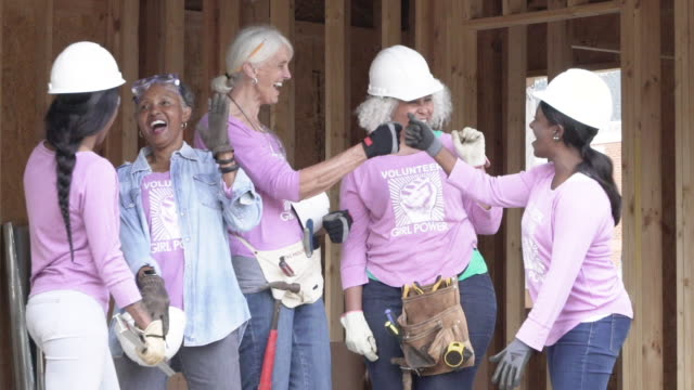 Female volunteer workers on a construction site