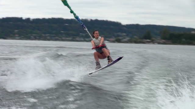 stockvideo's en b-roll-footage met female wakeboarder ends with letting go - moed