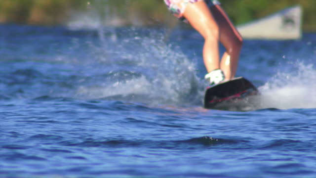 hd female wakeboarder on lake close-up (sm) - waterskiing stock videos & royalty-free footage