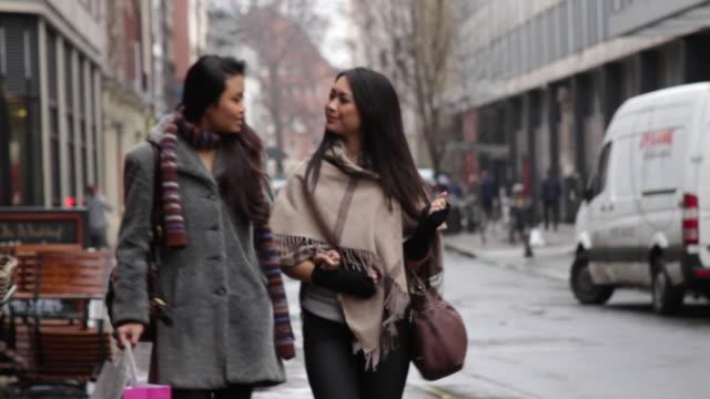 LS Female walking in shopping street