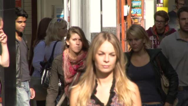 Female walking through crowd in busy street