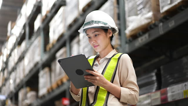 female warehouse worker checking cargo on shelves - manual worker stock videos & royalty-free footage
