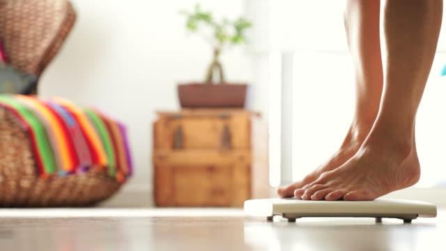 female weighing herself - tiptoe stock videos & royalty-free footage