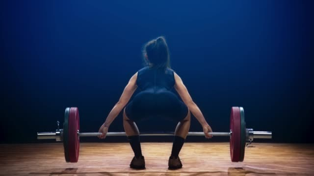 female weightlifter performing the snatch lift at a competition - standing stock videos & royalty-free footage