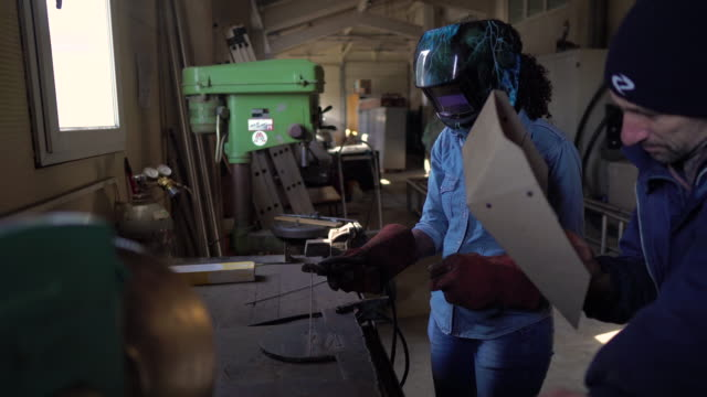 female welder in the workshop - manufacturing machinery stock videos & royalty-free footage