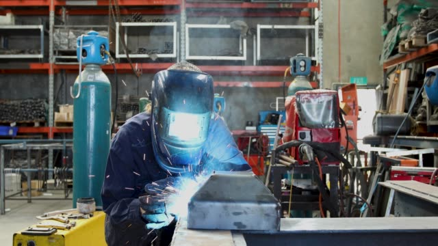 female welder - training course stock videos & royalty-free footage