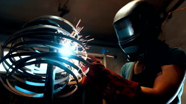 female welder work with welding machine - welding stock videos and b-roll footage