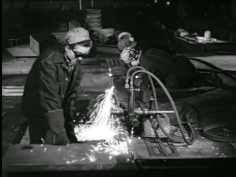 b/w 1943 female welders working in factory / industrial - steel worker stock videos & royalty-free footage