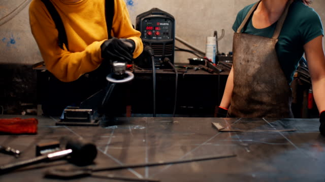 female welders working together - welding torch stock videos & royalty-free footage