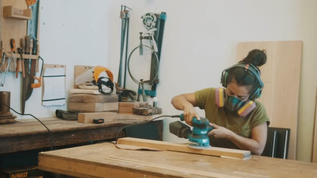 female woodworker polishes the surface (slow motion) - carpentry stock videos & royalty-free footage