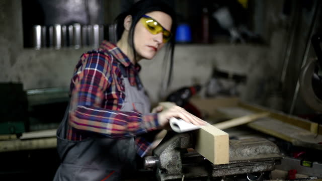 female woodworking - sand paper stock videos and b-roll footage
