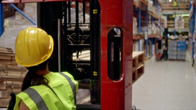 female worker driving on a forklift. warehouse - responsibility stock videos & royalty-free footage