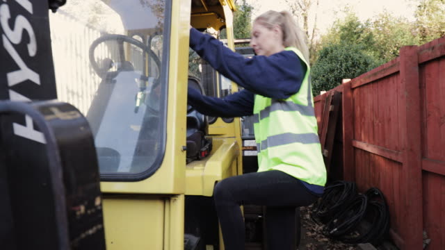 female worker getting into a forklift - trainee stock videos & royalty-free footage