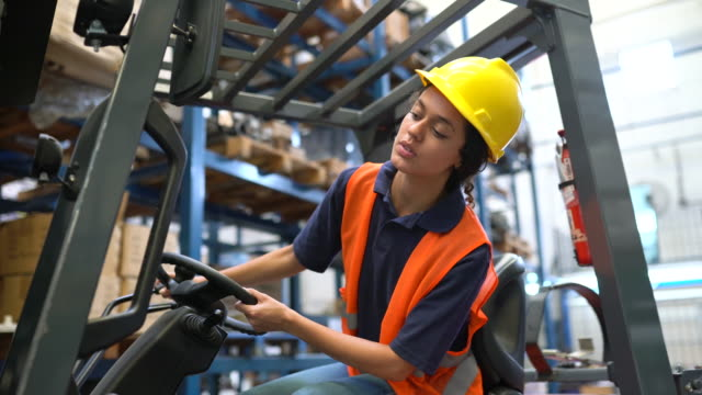 female worker operating forklift in warehouse - accuracy stock videos & royalty-free footage