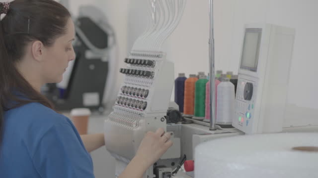 female workers in printing factory - embroidery stock videos & royalty-free footage