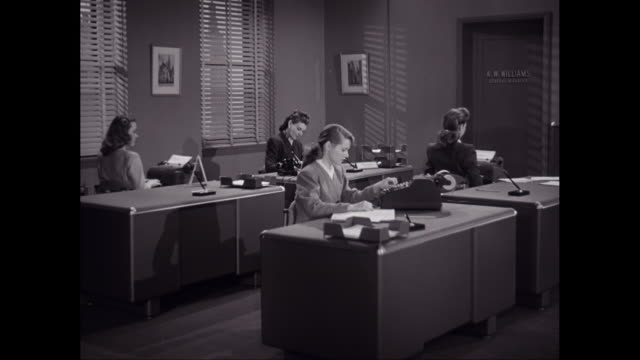 ms female workers using typewriter in office / united states - 1950 stock-videos und b-roll-filmmaterial