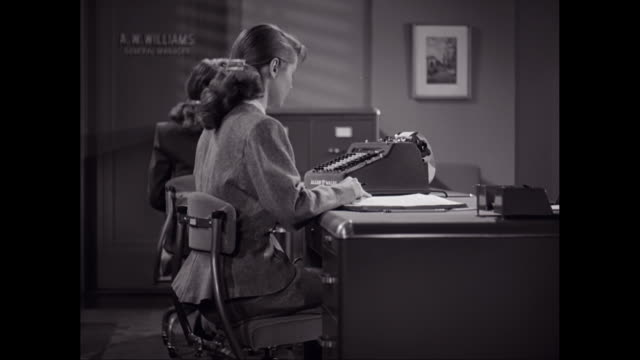 ms female workers using typewriter in office / united states - sekretärin stock-videos und b-roll-filmmaterial