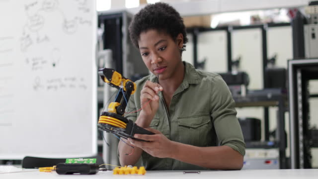 female working on robotics - females stock videos & royalty-free footage