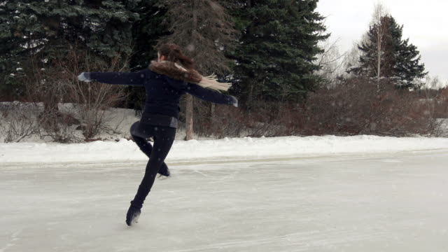 female young adult skates in freedom. - ice rink stock videos & royalty-free footage