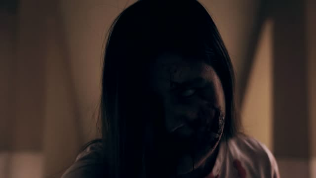 female zombie watching man attacking angry,shot of the horrible face of scary girl agonizing in exorcism,halloween concept - exorcism stock videos & royalty-free footage