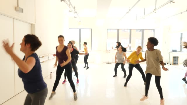 females enjoying dance with instructor in class - shaking stock videos & royalty-free footage