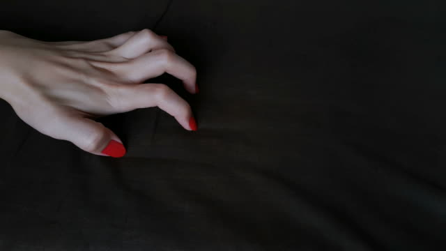 female's hand in sexual activity acting orgasm on dark bed sheet - human sexual behavior stock videos & royalty-free footage