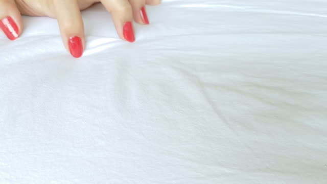 female's hand in sexual activity acting orgasm on white bed sheet - love making stock videos & royalty-free footage