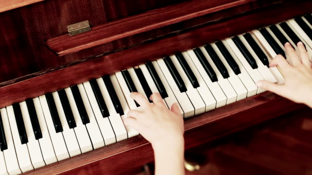 female's hand playing a piano - piano stock videos & royalty-free footage