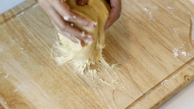 female's hands kneading dough for bread. - kneading stock videos and b-roll footage