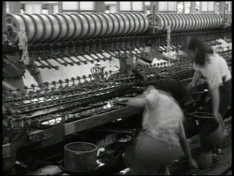 females in line working in textile manufacturing factory, female working on loom machine, biting string, thread. industry - postwar stock videos & royalty-free footage