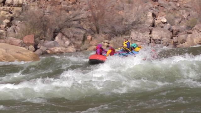 WS SLO MO TD PAN Females in red raft moving down rapid / Grand Canyon, Arizona, USA
