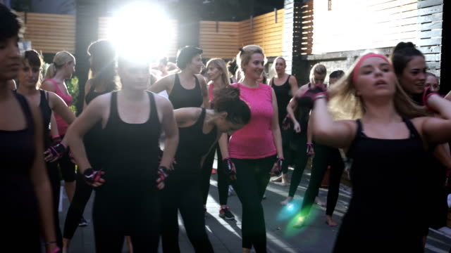 females listening fitness instructor before workout - strongwoman stock videos & royalty-free footage