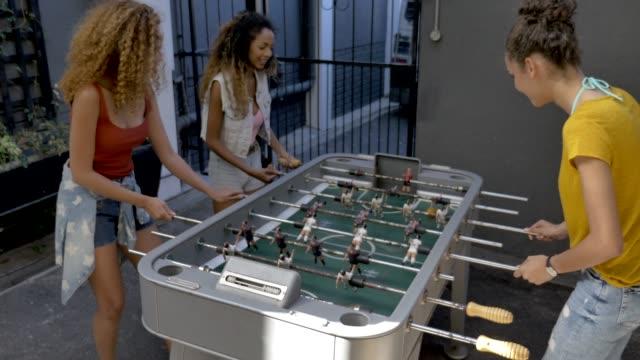 stockvideo's en b-roll-footage met females playing foosball at hotel - 14 15 jaar