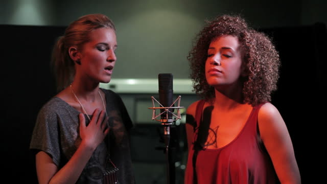 females singing duet in recording studio - performing arts event stock videos & royalty-free footage