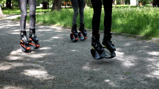 Females training outdoors with exercise equipment. Anonymous shot.