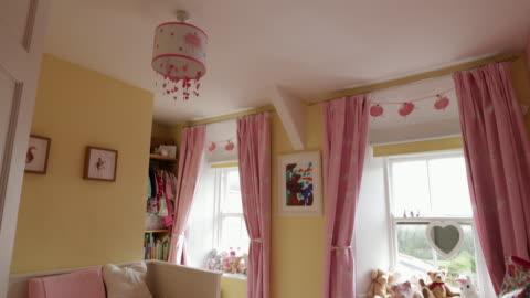 feminine childhood bedroom - pink color stock videos & royalty-free footage