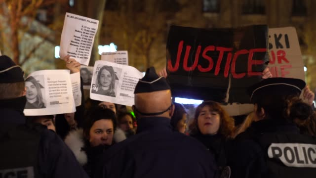vidéos et rushes de feminist activists protest against the nominations of roman polanski's film 'an officer and a spy', outside the dinner at le fouquet's, as part of... - cesar
