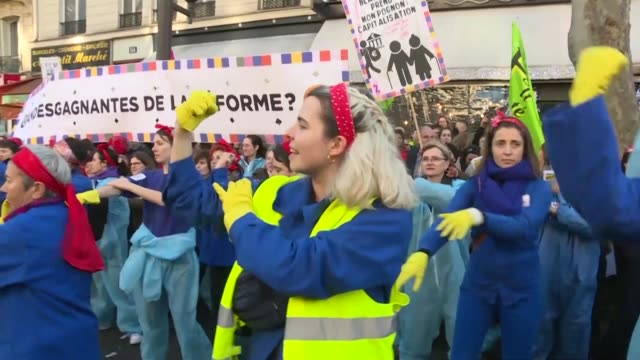 feminists wearing overalls proved a hit with the crowd as they performed their customised version of the 80s pop song a cause des garçons during... - customised stock videos & royalty-free footage
