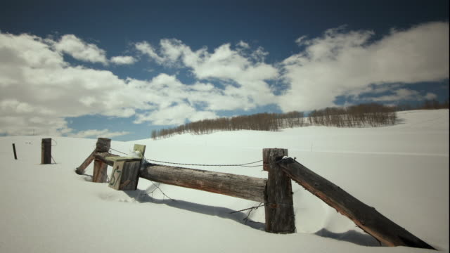 ws t/l fence in snow with cloudy sky / provo, utah, usa  - provo stock videos & royalty-free footage