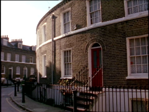 1997 fence surrounding brick rowhouses/ england - brick house stock videos & royalty-free footage