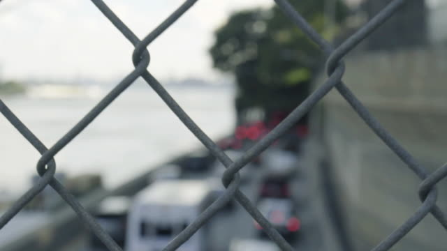 fence traffic - selective focus stock videos & royalty-free footage