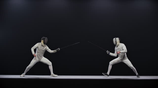 slo mo fencer victoriously clenching his fist after scoring a point - lottare video stock e b–roll