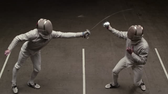 Fencers advance on each other, strikes and yells for his win