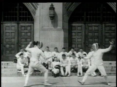 vídeos de stock, filmes e b-roll de 1948 montage fencers in competition / united states - enfoque de objeto sobre a mesa