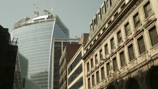 20 fenchurch street also known as the walkie talkie stands on the skyline in london uk on wednesday sept 4 tilt up office buildings and the walkie... - pavement stock videos & royalty-free footage