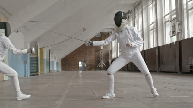 Fencing bout between two female athletes
