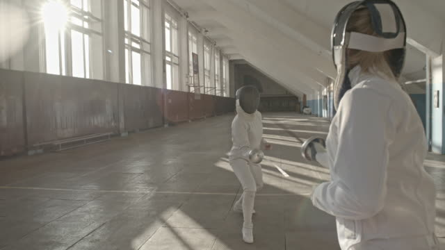 Fencing opponents training maneuvers with foil