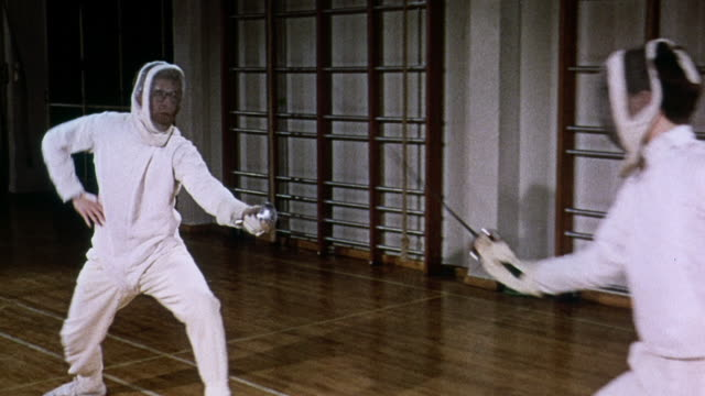 montage fencing practice with foils and full protective gear / united kingdom - fence stock videos & royalty-free footage