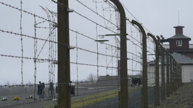 fencing surrounds buchenwald concentration camp on january 26 2018 near weimar germany tomorrow january 27 is international holocaust remembrance day... - konzentrationslager stock-videos und b-roll-filmmaterial